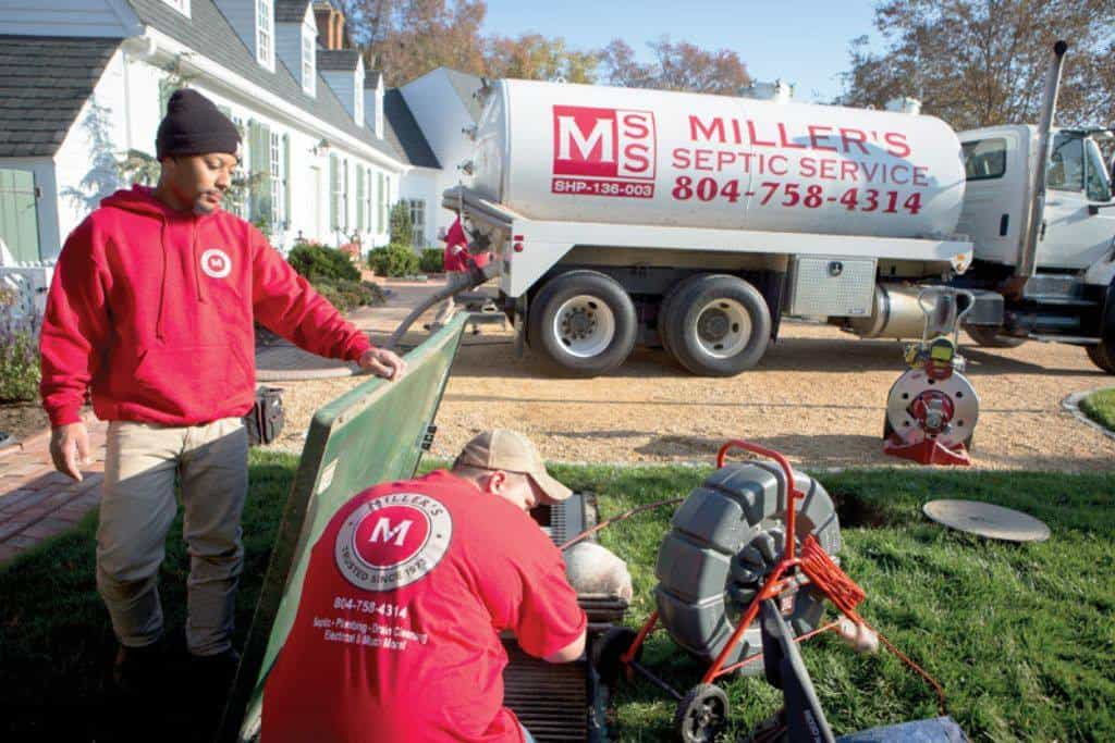 Miller's workers performing septic service