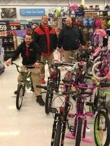 Miller's employees with the bike selection at Walmart